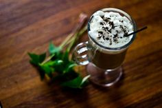 Magiccino Cocktail   1 oz Black Magic 1/2 oz Irish Creme Liqueur Hot Coffee Whipped Cream