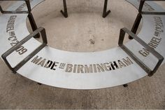 Laser cut steel public furniture as part of an outdoor exhibition/signage suite by: http://www.studiomakgill.com