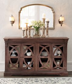 Complete a sideboard's look with a stunning mirror like this one.