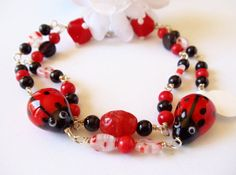 Lampwork Ladybugs Black Onyx Red Coral and by simplysuzie2 on Etsy, $30.00