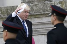 London Mayor Boris Johnson appears to salute one of the troops lining the steps of St Paul...