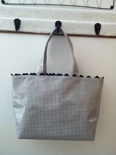 I own several of Beth's oil cloth market bags.. they are super tough.. clean up with a clorox wipe .. are beautifully made, hold serious weight, last for years and are cute as can be. Love them.