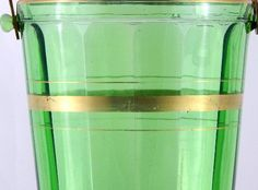 Ice Bucket Tub Elegant Vintage Depression Green Glass Paneled Sides Gold Trim    Been looking for a vintage ice bucket that could have been in a swanky 1930's New York 5th Avenue apartment bar or a Hollywood movie mogul's poolside bar, this lovely green glass ice bucket is it!     This elegant ice bucket made by one of America's finest Depression Glass manufacturers has a quite lovely dark green glass, vertical panels on the inside giving off optic illusions, decorated with gold trim, and…