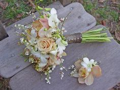 Bridal bouquet and groom boutonniere for fall. An elegant hand tied bouquet of lily of the valley, roses, orchids and callas.