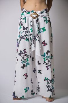 """Super soft organic cotton wide-leg Thai style palazzo pants with elastic back waistband. Sizing: One size fits most. Measurement  Waist: 32"""" - 38""""(Max stretch) Hip: up to 50"""" Length: 38"""" Inseam: 23"""""""