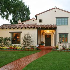 Terracotta roof tiles and grey solver beaver walls for Spanish revival exterior paint colors