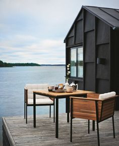 black lake house +  deck + dock + dining