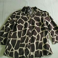 East 5th Animal Print Top This brown and tan East 5th top is a size medium and made of 55% linen and 45% rayon. It measures at 25 inches long and 19 inches across the bust line.. East 5th Tops Button Down Shirts