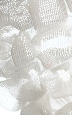 Knit sample with delicate white textures; knitwear; textiles for fashion // via WGSN