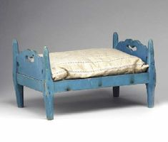 A BLUE-PAINTED DOLL BED LANCASTER COUNTY, PENNSYLVANIA, 1825-1845