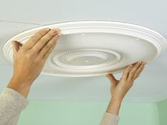 FOURTH STEP How to Install a Ceiling Medallion: Position the rosette or medallion on the ceiling, inside the edge guide line and with holes in line with the joists. Apply light, even pressure. From DIYnetwork.com