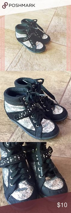 justice wedge hi-tops • has hidden inside wedge • lace-up & velcro strap closure • has silver sequins detail • excellent condition: wear on bottom soles only Justice Shoes Sneakers