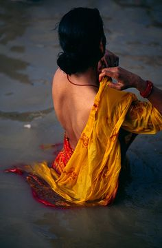 baby-sanyasi:  A female pilgrim bathing in the Ganges river in India. Photographed by Dariusz Klemens. This is a beautiful photograph.