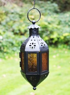 Small Orange Glass Hanging Moroccan Candle Lantern with Chain GiftGuys,http://www.amazon.com/dp/B00FN346A4/ref=cm_sw_r_pi_dp_jJEltb1G7ZR6M799
