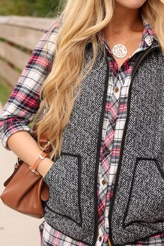Plaid + tweed. Emulate with red/ivory plaid flannel shirt and gray tweedy skater skirt.