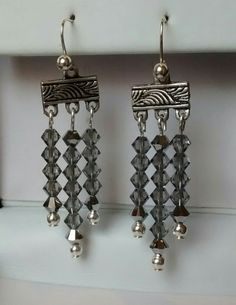 Handmade drop earrings, with Swarovski crystal beads, by Flaire Creations and available to buy from Etsy.