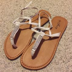 White sandals White and tan sandals, worn once Foxy Shoes Sandals