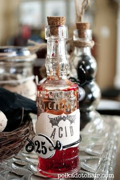 Potions centerpiece -- from @Melissa Squires {polka dot chair} #halloween #decor