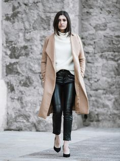 Aria di Bari paired an oversized camel coloured coat over a creme white turtleneck and leather pants.