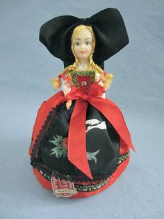 Charming doll wearing a typical Alsatian costume, from the Alsace region of France. She wears the most often represented costume, with a black bow