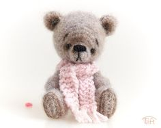 Amigurumi miniature teddy bear toy, crochet stuffed plush bear animal with clothes   Miniature 5-way jointed 3,5 inches (9cm) teddy bear.  It has been crocheted from a blend of alpaca, polyamide and merino yarn, it has black bead eyes, its facial features have been stitched with a black cotton thread and lightly shaded. It wears a pink knitted pompom hat and scarf. Bear Animal, Teddy Bear Toys, Crochet Teddy, Pom Pom Hat, Plush Animals, Cotton Thread, Wool Yarn, Black Cotton, Facial