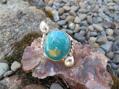 A bohemian Turquoise ring with a little artistic flair to it.  This is #394, size 8 by Sandy River Jewelry