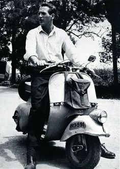 Paul Newman riding a Vespa Scooter