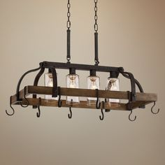 Clear seedy glass adds to the industrial inspired look of this bronze pot rack chandelier. Canopy is 13 wide x 4 deep x 2 high. Includes of chain and wire. Style # at Lamps Plus. Kitchen Island Pot Rack, Kitchen Island Chandelier, Kitchen Island Lighting, Jar Chandelier, Bronze Chandelier, Chandeliers, Pendant Lighting, Pot Rack Hanging, Hanging Pots