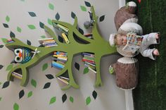 """Tree shelf playroom with green rug """"grass"""" and log pillows. Too perfect."""