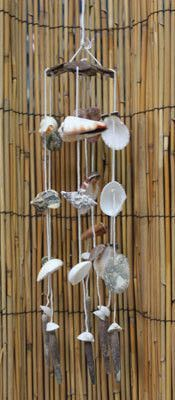 "Beach Flower Windchime Adorable Little Coconut Shell Flower Top with 7 strings of Small Shells and sliced shells. Each chime is slightly different shells. Approximate Size 12-16"" x 2.5"""