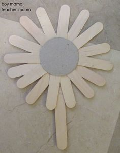 Popsicle Stick Sunflowers  need: cardboard, popsicle sticks halved, 1 whole popsicle stick, paint.