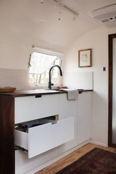 <p>The couplebehind The Modern Caravanthoughtfullyrestored their beloved 1977 Airstreamand chose our 1x6 tiles in Tusk for their kitchen backsplash.</p>
