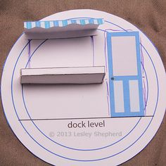 Make Your Own Beach and Pier in a Teacup: Position the Door and Window On Your Teacup Beach Shop Front