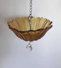Vintage glass turned beautiful, sun-catching birdfeeders! Give the birds a real treat in one of these bad boys. Each feeder is 100% unique and one of a kind. You wont find another just like it! This particular piece is made using a vintage flower bowl, and a prism to catch the