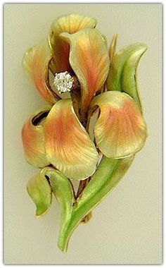 Art Nouveau Iris Brooch. Crafted in 14kt gold and set with an Old European-cut diamond,  the brooch was created around 1900.
