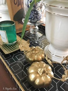 Give thrift shop pumpkins new life with a shot of @rustoleum metallic gold spay paint!
