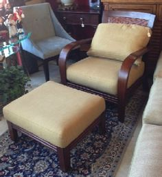 "A new take on Mid-Century rattan furniture by Ethan Allen. Made of fine grained wood instead of bamboo, with woven cane back. behind loose cushion. Mahogany finish, tawny fabric. Chair, 31.5"" x 29"" x 35"" tall. Ottoman, 21"" x 25"" x 16""."