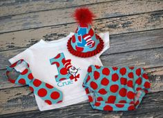 Image from http://www.artfire.com/uploads/product/9/359/61359/7561359/7561359/large/birthday_hat_diaper_cover_tie_-_smash_cake_-_seuss_cat_in_the_hat_803abbbf.jpg.