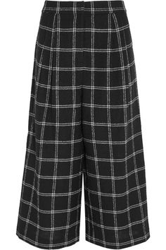 Tibi's black 'Edie' culottes are knitted from wool-blend that's woven with touches of alpaca and decorated with a white checked motif. Timelessly smart and sophisticated, they have a flattering mid-rise silhouette accentuated by waist-defining pleats. Wear yours with a tucked-in blouse.