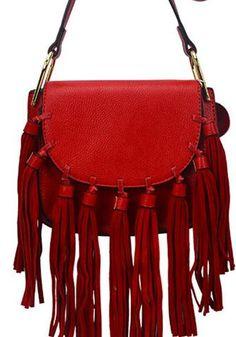 Horseshoe shaped fringed flap bag. Features 9 tassels.