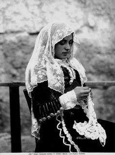 Woman in traditional costume Sardinian Osilo
