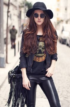 Round shades, fringes and leather pants.