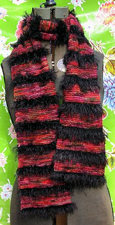 Rock Star Scarf. US #3 needles. [MC] 2 Skns Koigu [176 yds/skn] [CC] 1 Skn GGH Apart [120 yds/skn]. Using CC, co 35 sts. K in garter st for 6 rows. Switch to MC and K in garter st for 18 rows. Cont. knitting, following pattern as established until 1 yd of CC remains. Cast off loosely.  Weave in ends.