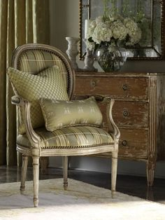 I love this chair. One of my favorite design styles, and looks wonderful in this pattern and color.