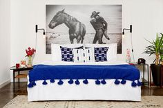 Black and white horse photo in bedroom