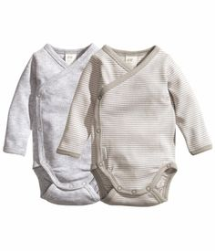 2-pack Bodysuits: Long-sleeved, wrapover bodysuits in soft organic cotton jersey. Snap fasteners at side and gusset. One solid-color and one striped.