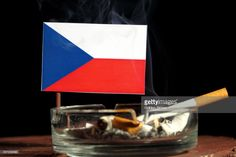 Stock Photo : Czech flag with burning cigarette in ashtray isolated on black background