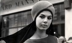 """""""Model Linda Keith in a helmet-style hat with scarf, 1963."""""""