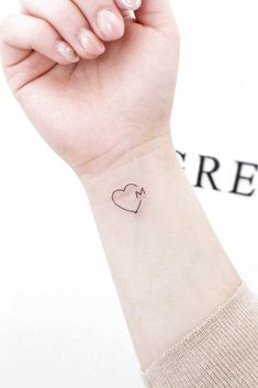 Heart With Letter Tattoo Design ★ Small but meaningful wrist tattoos designs can be explored here. Pick a tiny rose flower or vital words, or some other cute feminine tattoo. initial tattoo 33 Delicate Wrist Tattoos For Your Upcoming Ink Session Small Heart Tattoos, Small Wrist Tattoos, Tattoos For Women Small, Couple Wrist Tattoos, Small Matching Tattoos, Tattoo Designs On Wrist, Small Heart Wrist Tattoo, Small Feminine Tattoos, Small Tattoos With Meaning