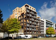 The Cube, The UK's tallest hybrid cross laminated timber (CLT) structure, providing 50 homes over 10 storeys on a unique cruciform plan. Contemporary Architecture, Architecture Design, Wooden Architecture, Green Architecture, Wooden Skyscraper, Green Apartment, Timber Buildings, Timber Structure, Student House